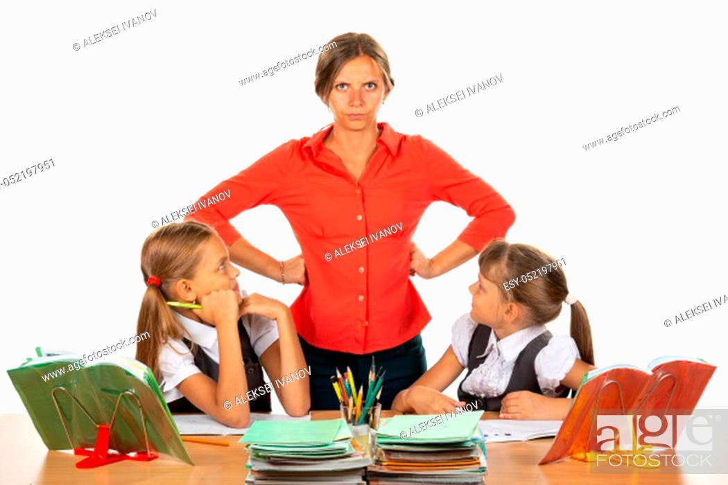 Stock Photo: Children look at an evil teacher.