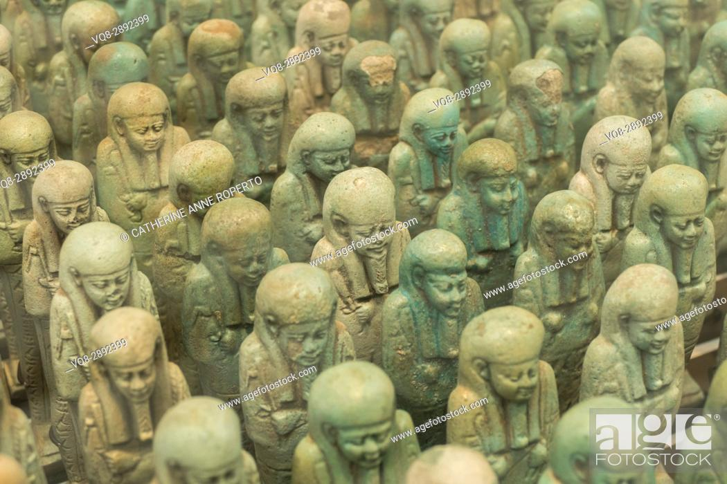 Stock Photo: Many headed jade coloured funerary shabtis with stylised beads and symbolic regalia, Louvre-Lens Museum. Lens, France.