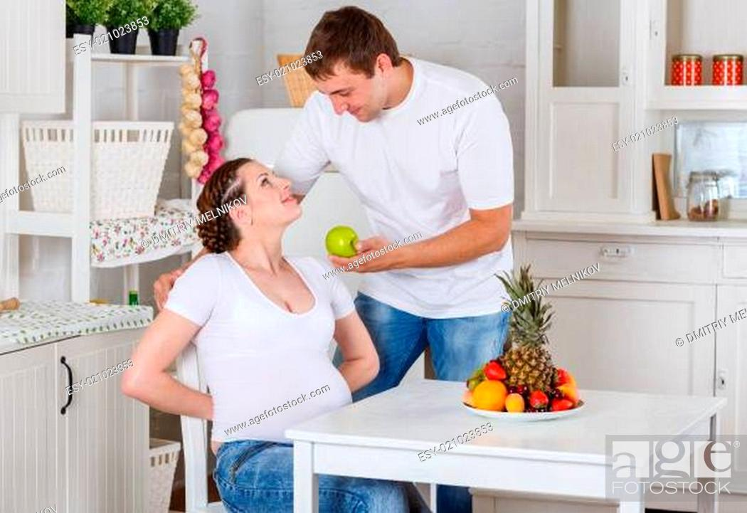 Stock Photo: Happy pregnant family and healthy food.