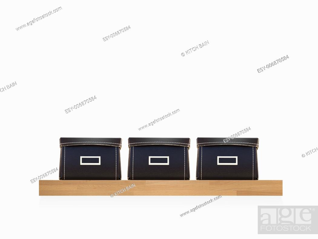 Stock Photo: Storage boxes isolated on a wooden shelf.