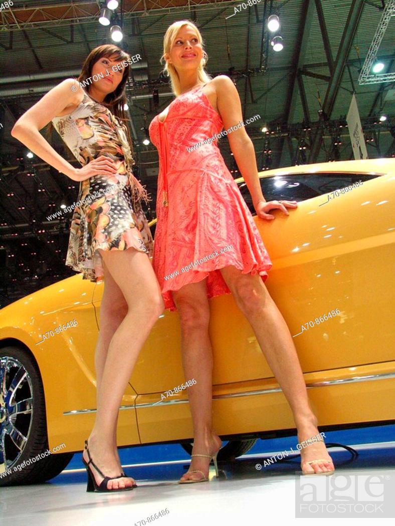 Stock Photo: Models posing in front a Brabus prototype. 77 International Geneva Motor Show (march, 2007).
