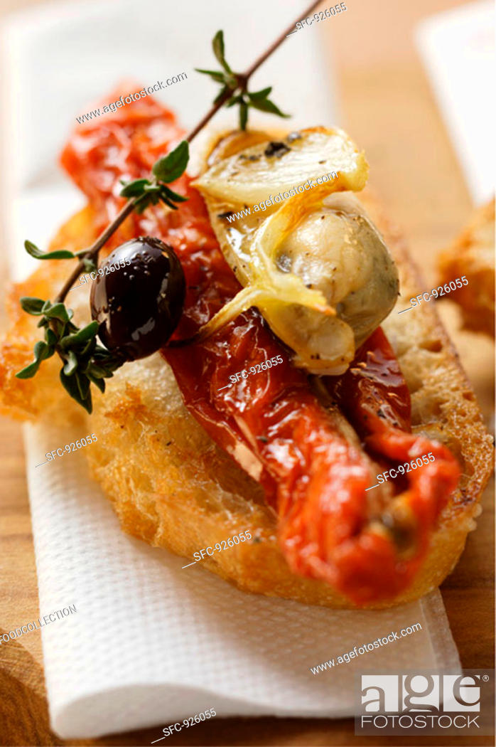 Stock Photo: Crostini with seafood and dried tomatoes.