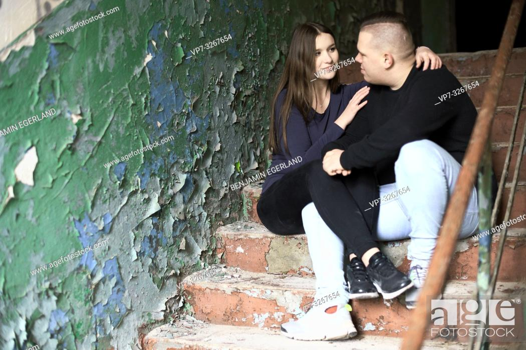 Stock Photo: couple sitting on stairs in house ruin, in Cottbus, Brandenburg, Germany.
