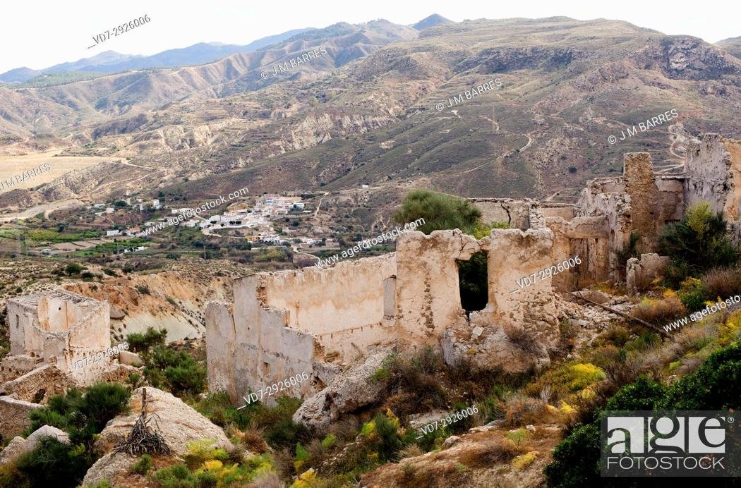 Stock Photo: Marchalico Viñicas, abandoned village in gypsum karst of Sorbas with La Herreria at bottom. Almeria province, Andalucia, Spain.