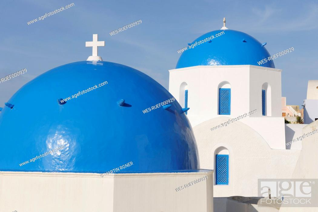 Stock Photo: Greece, View of classical whitewashed church at Oia.