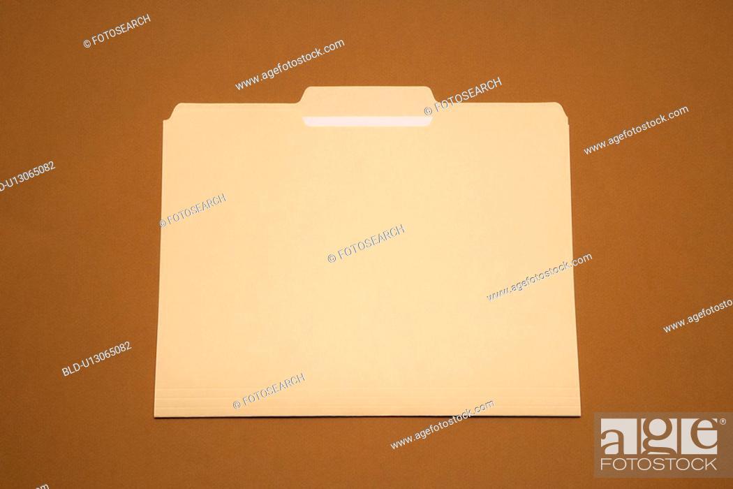 Stock Photo: Blank folder on brown background.
