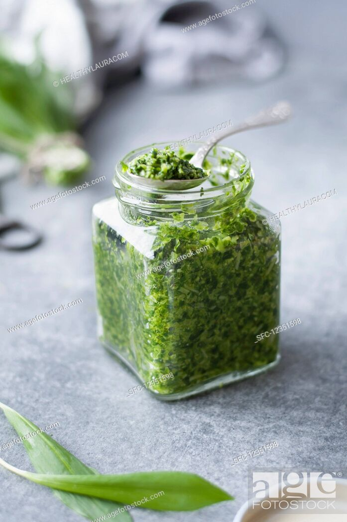 Stock Photo: Pesto made with garlic, olive oil, parmesan, cashew nuts, basil, rocket, and wild garlic.