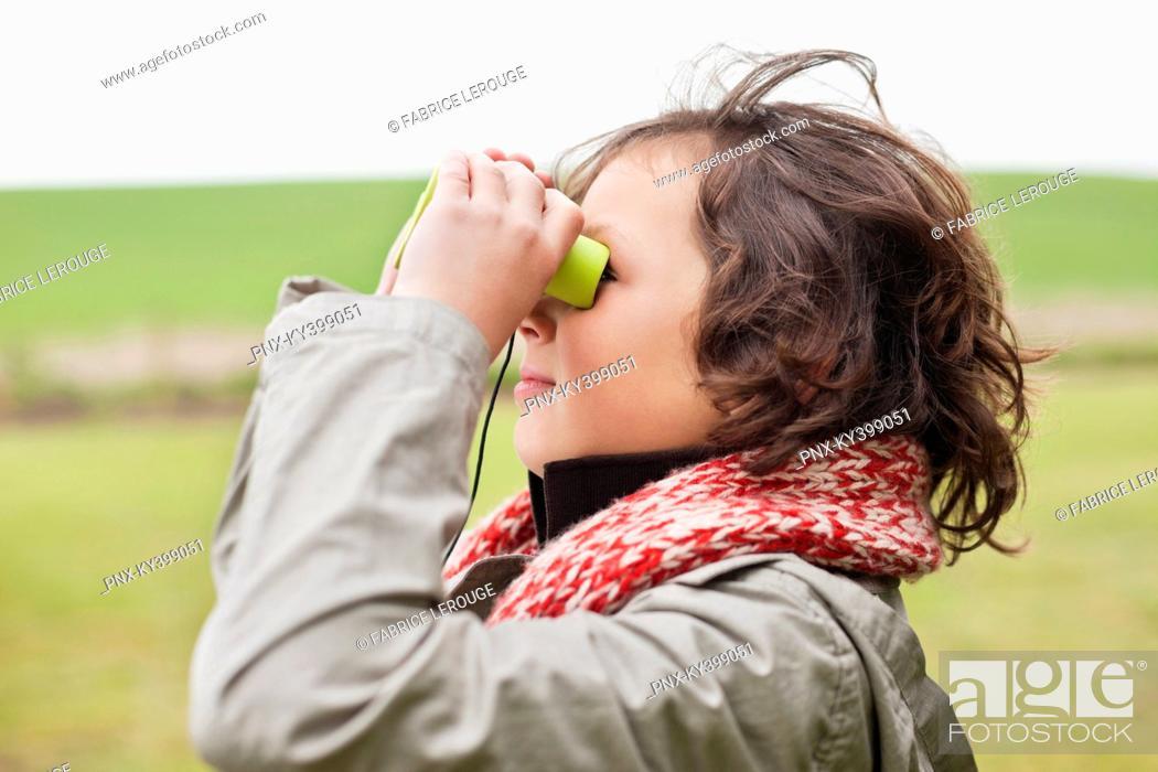 Stock Photo: Boy looking through binoculars.