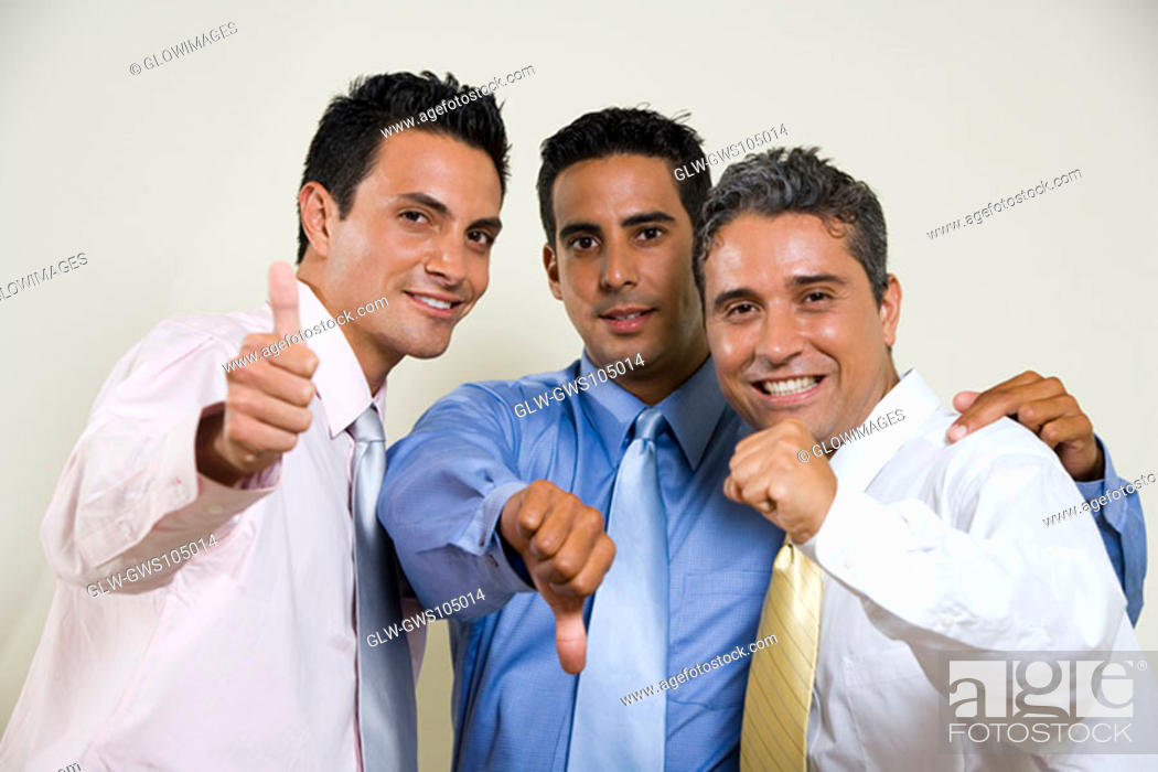 Stock Photo: Portrait of three businessmen gesturing thumbs up.