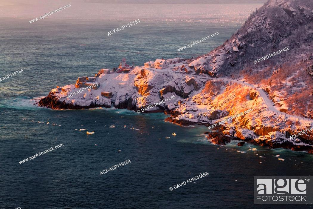 Stock Photo: Sunrise on snow covered morning at the Queens Battery & Barrackslooking toward Fort Amherst, Signal Hill National Historic Site, St.