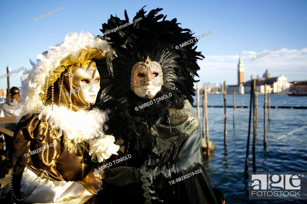 Participants at the Venice carnival in San Marco square in