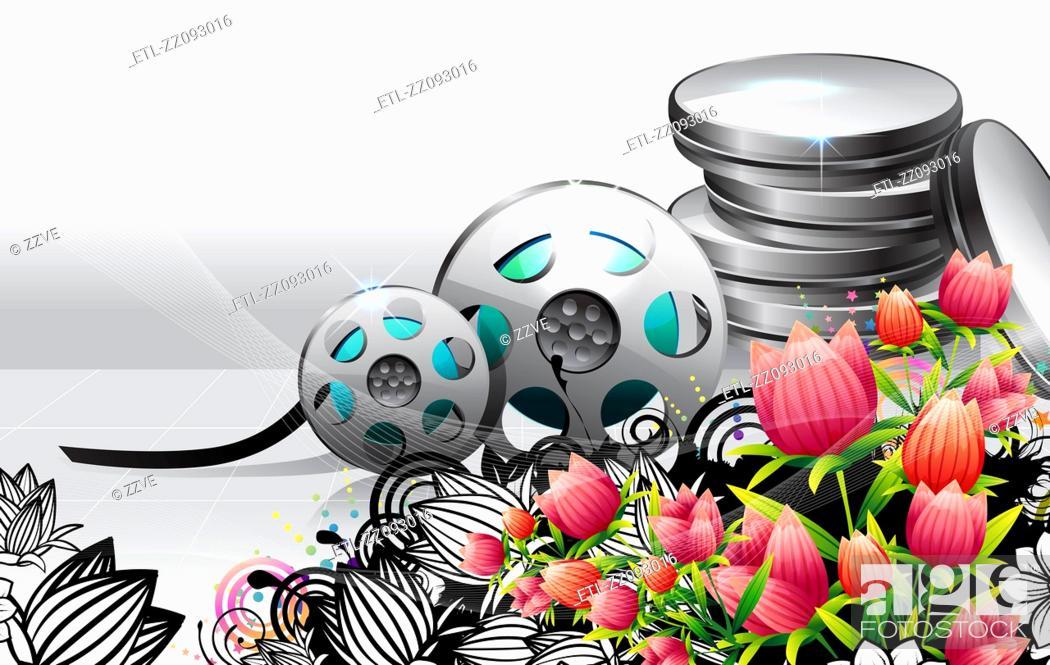 Stock Photo: Film spools with flora design.