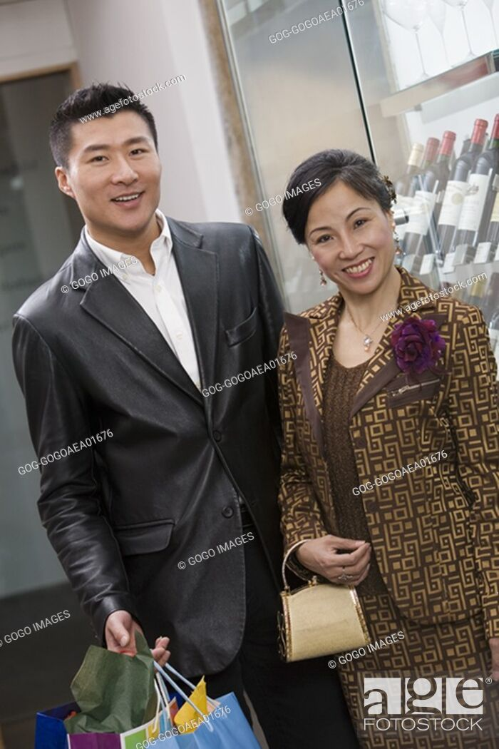 Stock Photo: Man carrying wife's shopping.