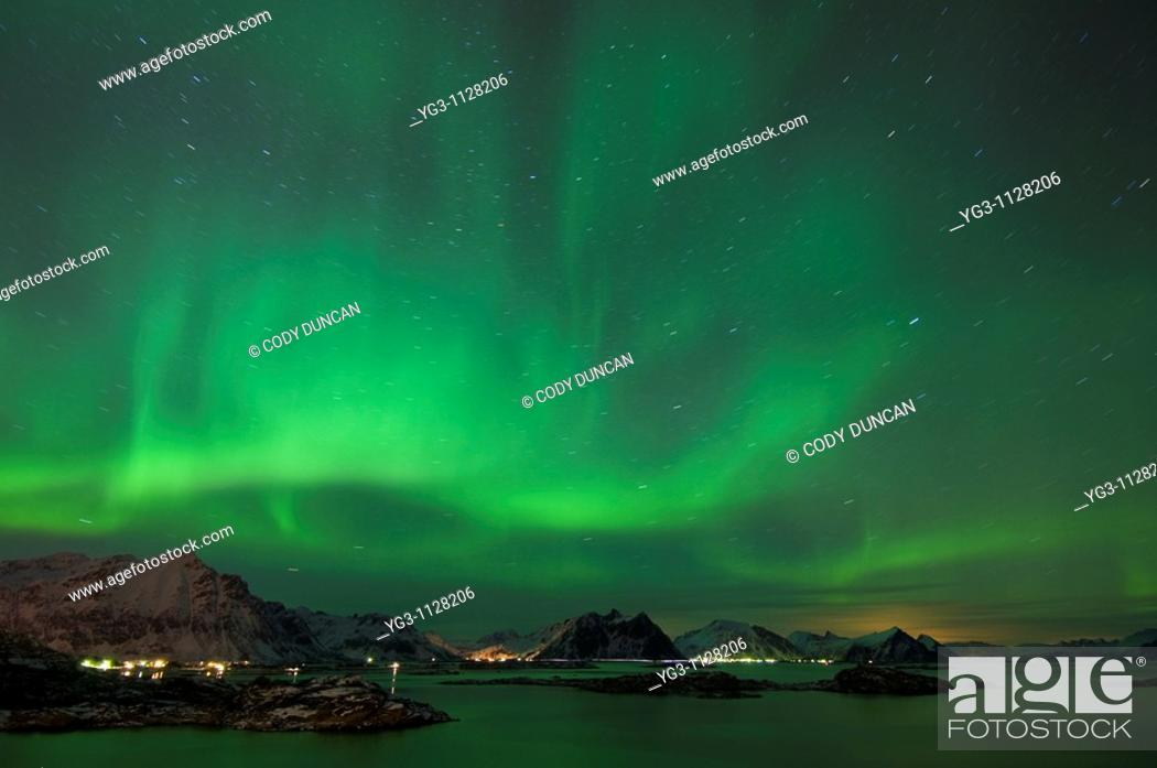Stock Photo: Northern lights shine above mountain peaks of Lofoten Islands, Looking north from Stamsund, Vestvågøy, Norway.
