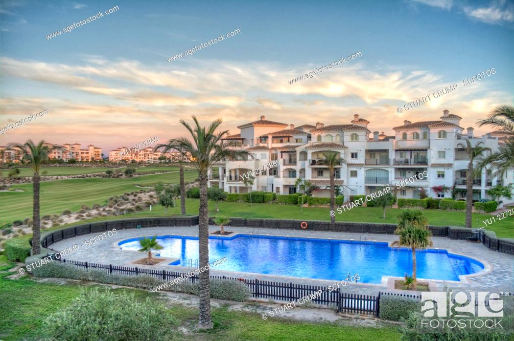 Stock Photo: HDR image of the Swimming Pool and Golf Course from an apartment on Hacienda Riquelme Golf Resort, Murcia, Spain.