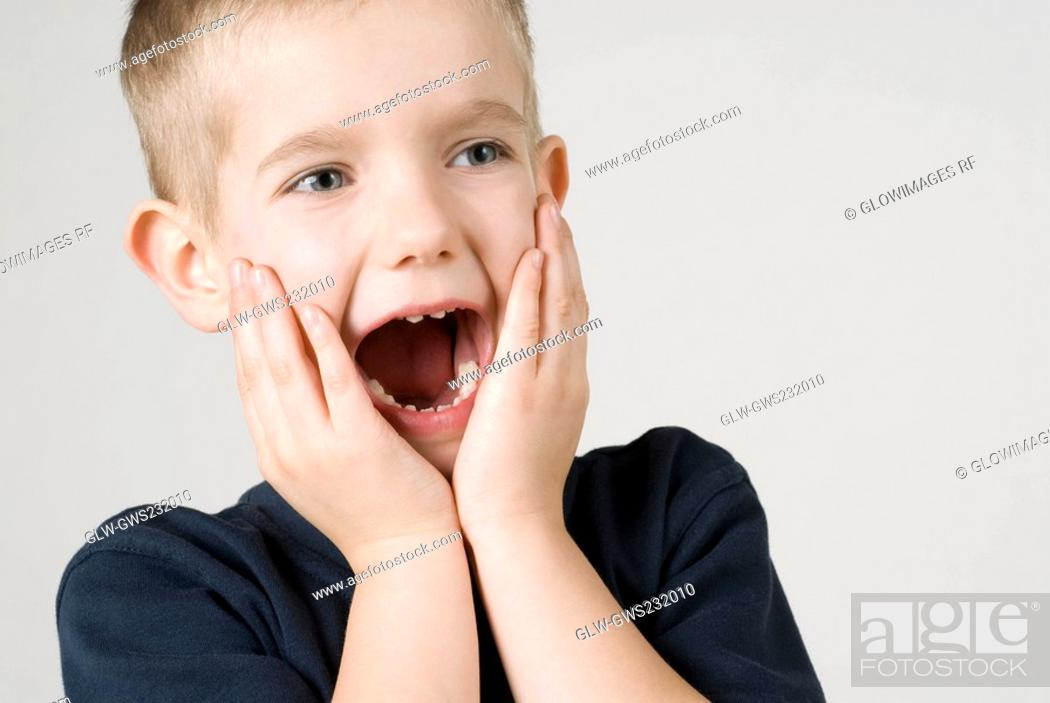 Stock Photo: Close-up of a boy shouting.