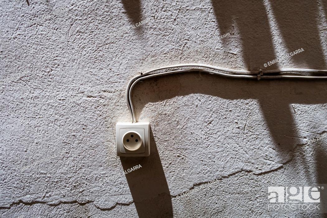Stock Photo: plug in a wall.