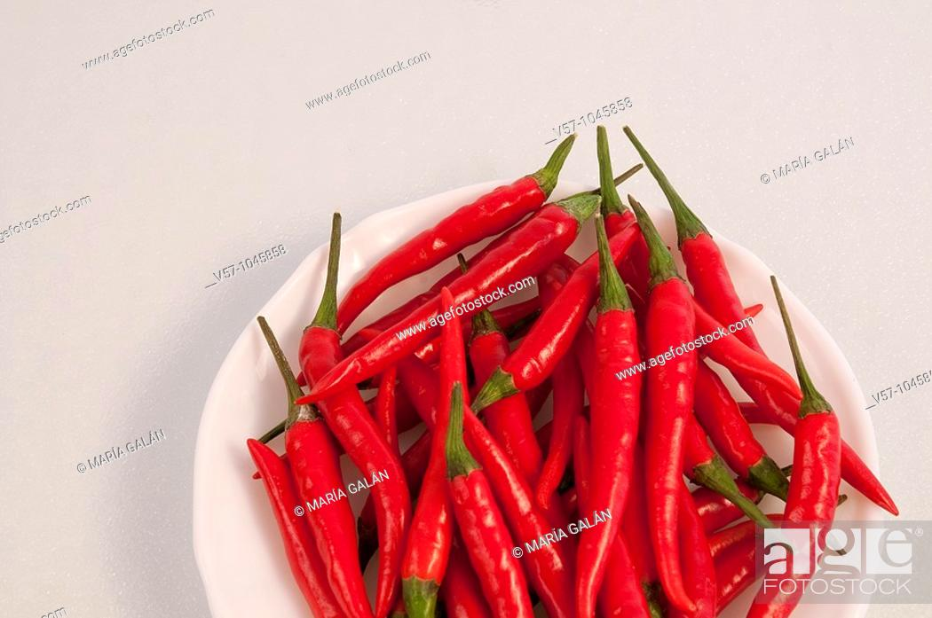 Stock Photo: Red chili peppers on a dish.
