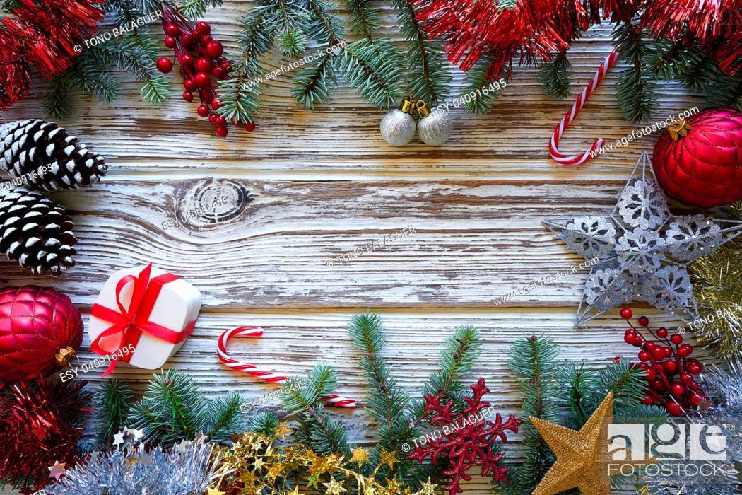Stock Photo: Christmas border frame on white wooden background.