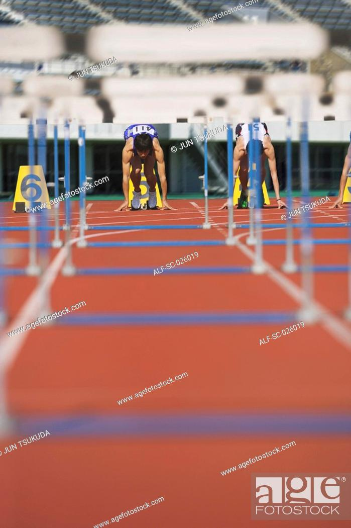 Stock Photo: Runners at Starting Line.
