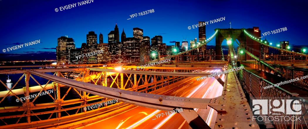 Stock Photo: Panorama of Brooklyn bridge busy traffic at night and Manhattan skyline with skyscrapers.