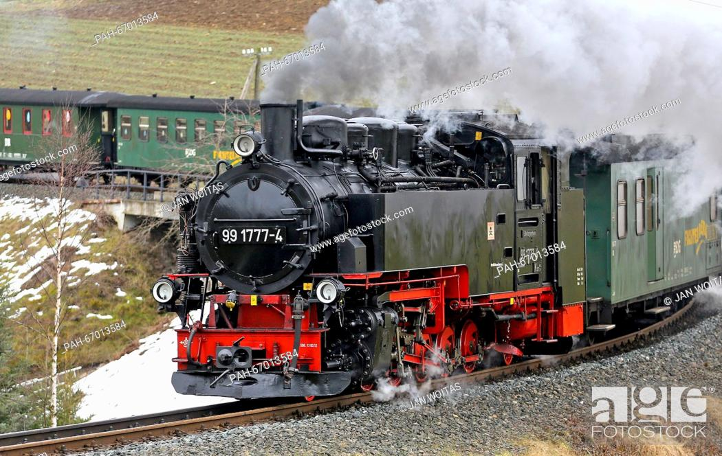 Stock Photo: The Fichtelberg mountain railway going uphill from Cranzahl towards Oberwiesenthal, Germany, 21 March 2016. According to the Saxonian Steam Train Society (SDG).