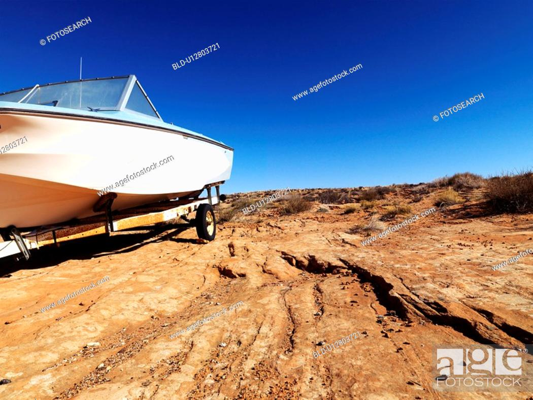 Stock Photo: Landscape of motorboat sitting in the middle of the desert in rural Arizona, United States.