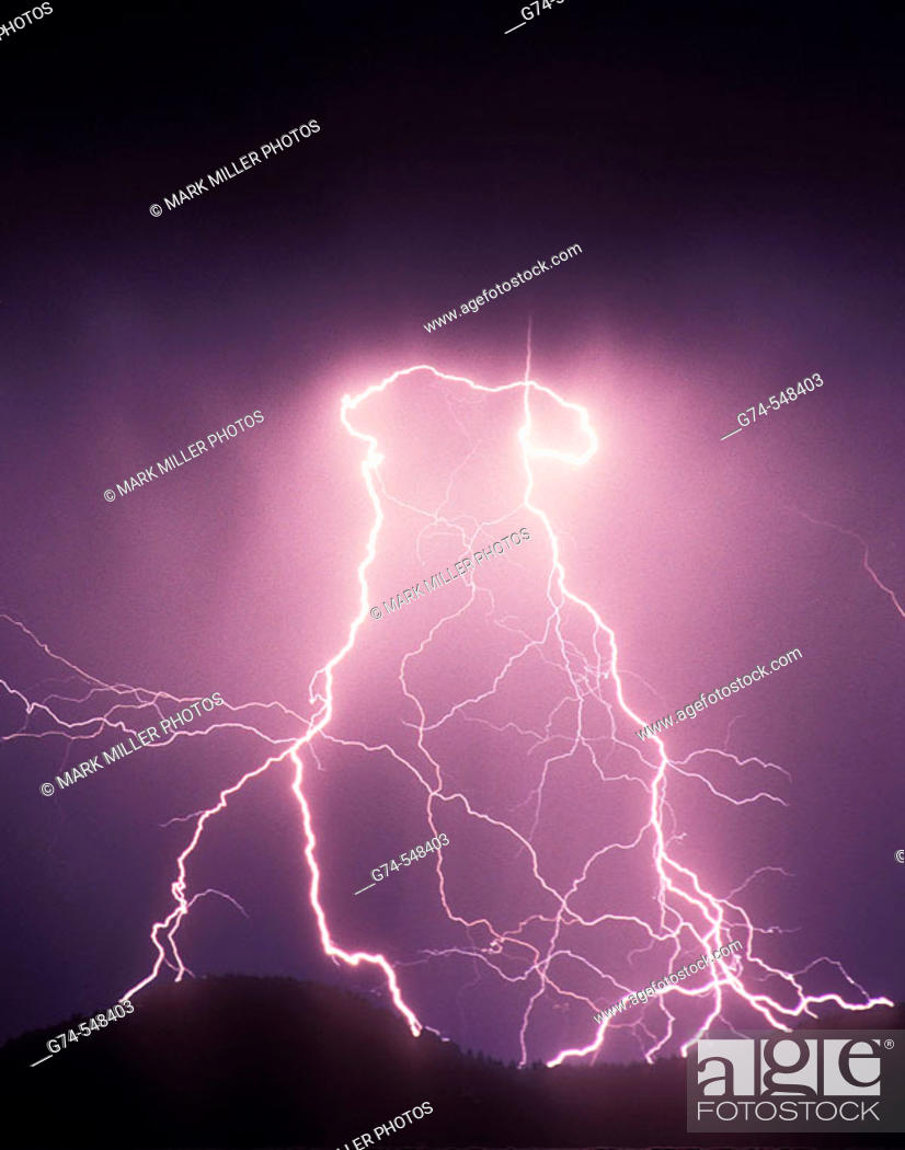 Stock Photo: Evening Lightning storm over the mountains.