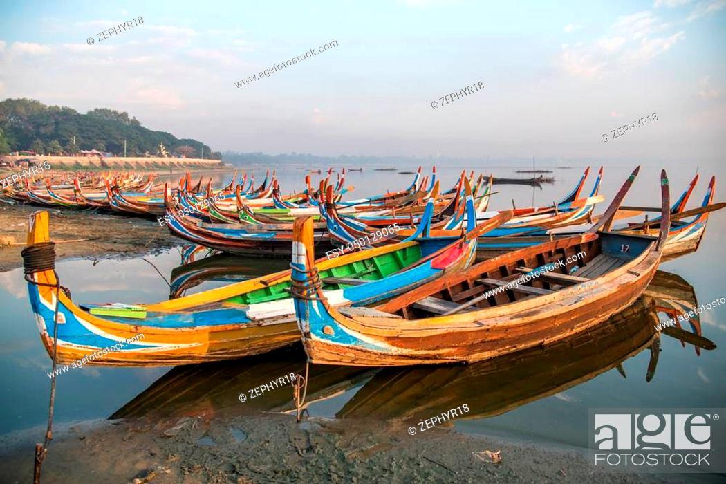 Stock Photo: group of traditional boat in Taungthaman Lake near the U Bein Bridge, famous landmark and tourist attraction of Amarapura Township, Mandalay, Myanmar (Burma).