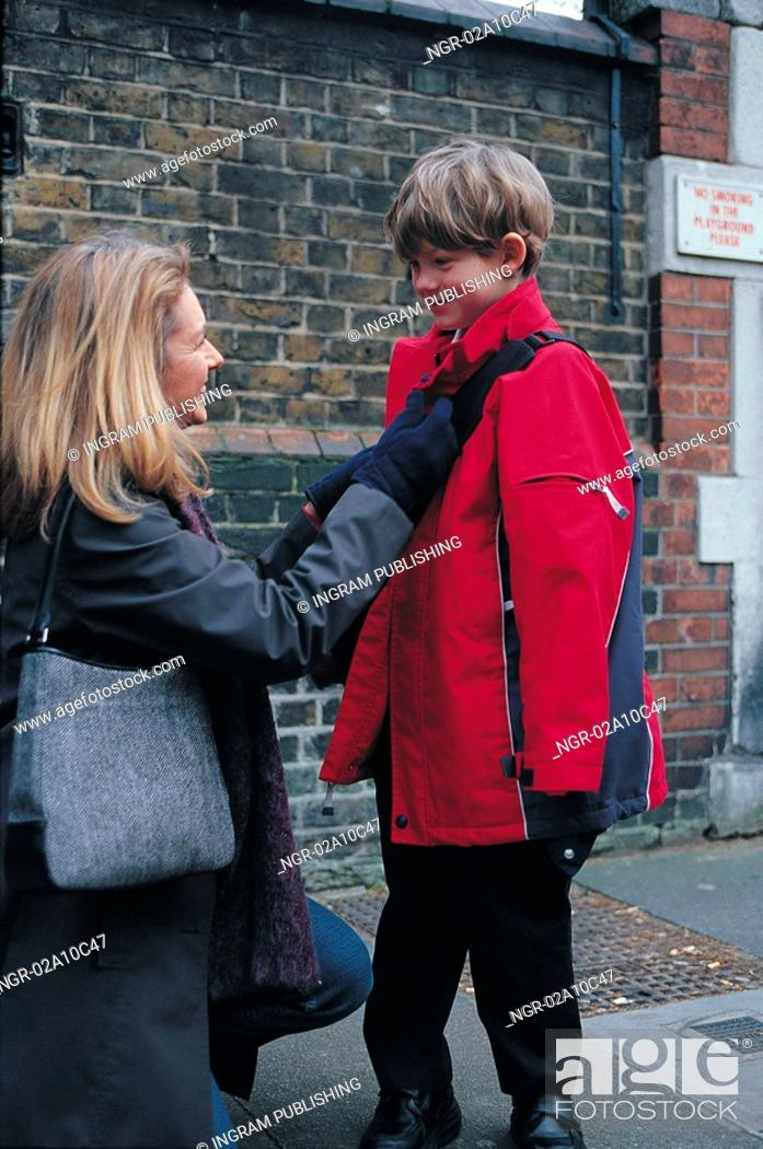 Stock Photo: Mother and son on a sidewalk.