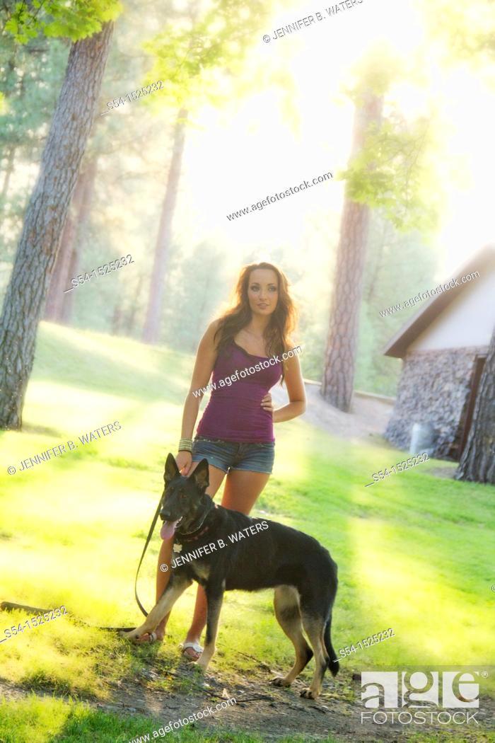 Stock Photo: Beautiful young caucasian woman with her German Shepherd dog in Spokane, Washington, USA.