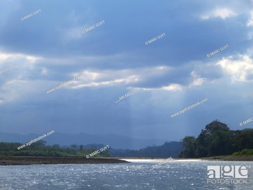 Stock Photo: Dark rain clouds over the Alto Madre de Dios River in the Lower Amazon rainforest in Madre de Dios department in Peru.