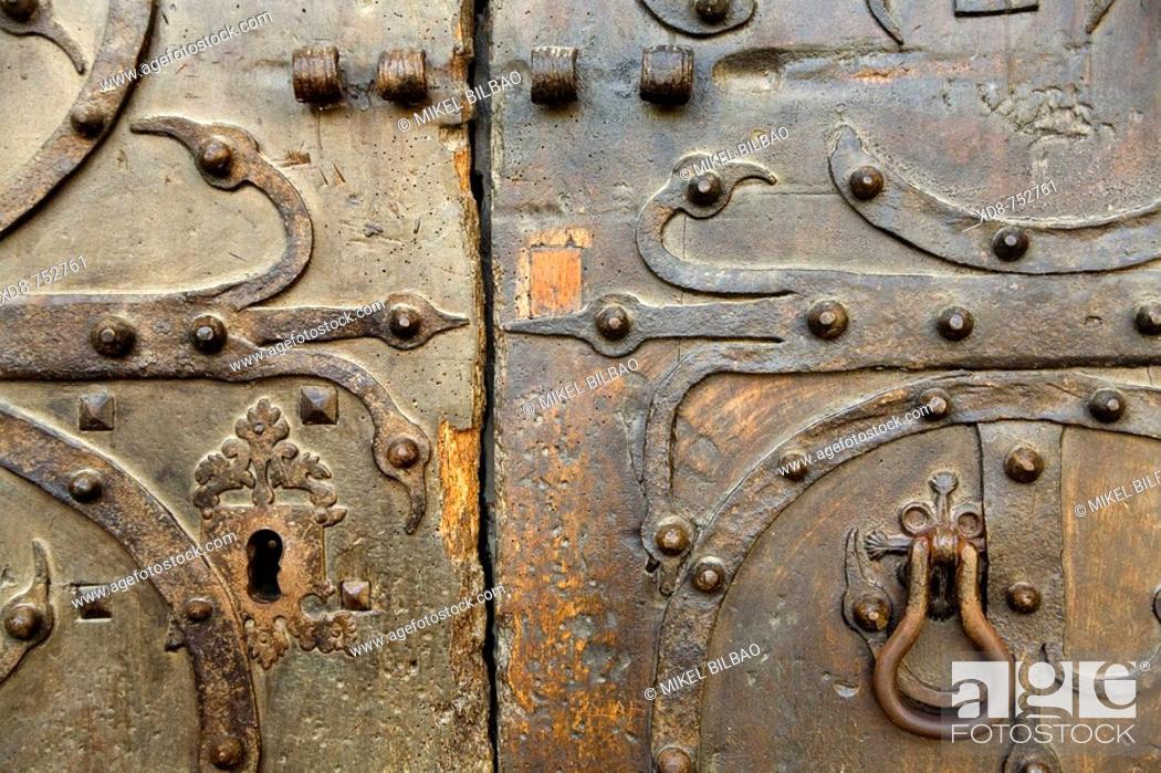 Stock Photo: Old lock on a wooden old door, church of St Miguel, Estella, Navarra, Spain, Europe.