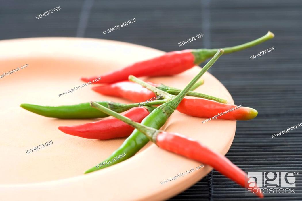 Stock Photo: Chilli peppers on a plate.