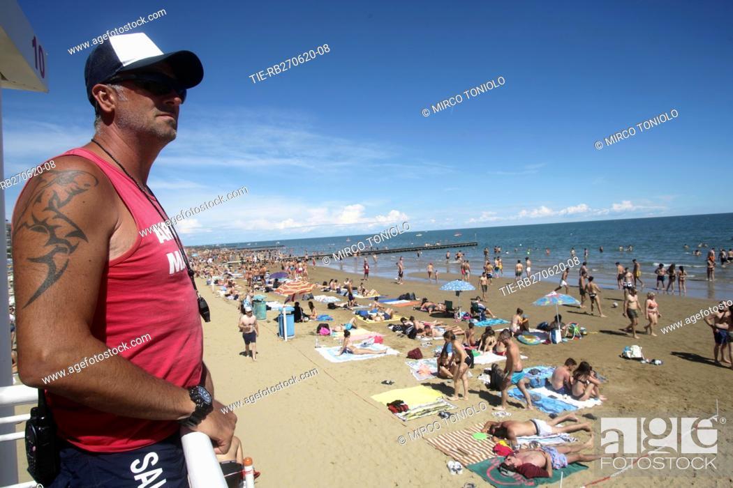 Stock Photo: People on the Jesolo beach , ITALY-27-06-2020.