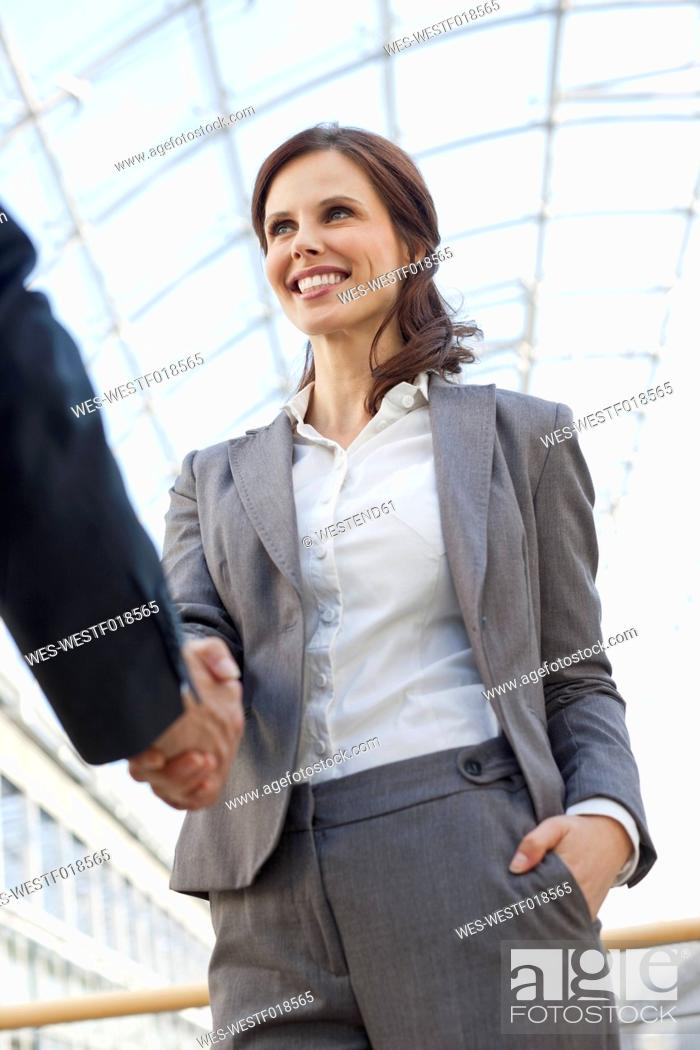 Stock Photo: Germany, Leipzig, Business people shaking hands.