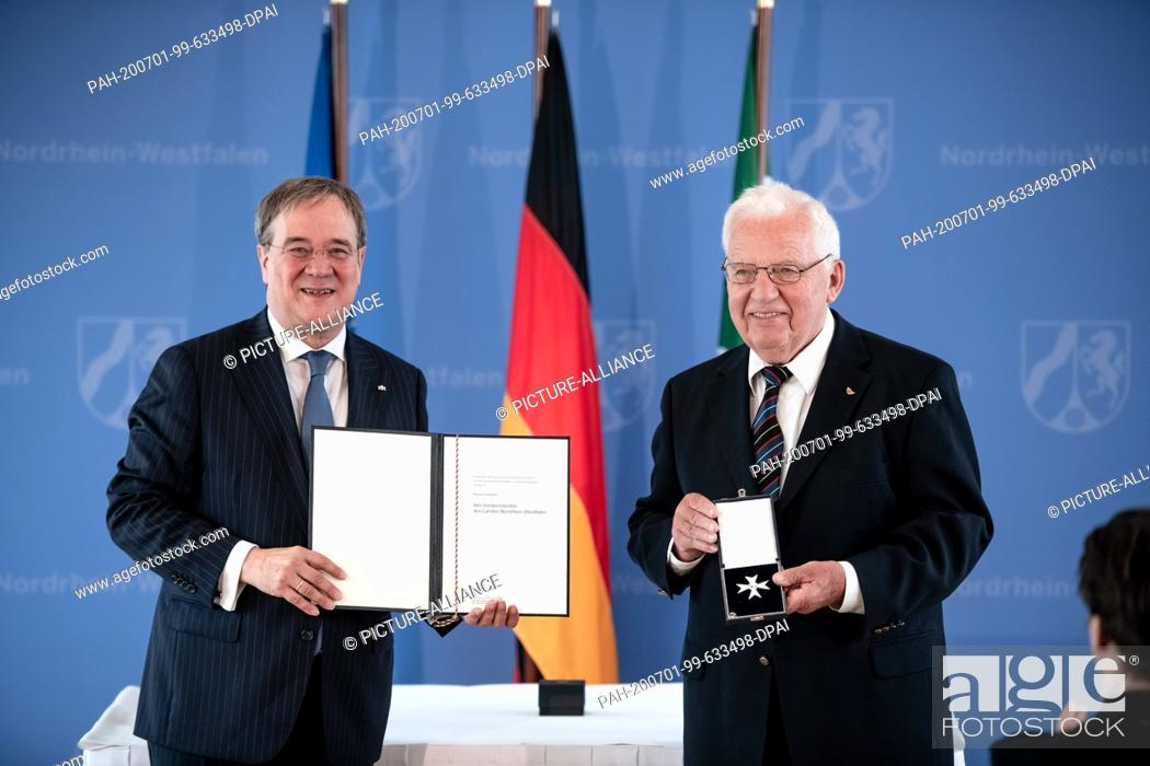 Stock Photo: 01 July 2020, North Rhine-Westphalia, Duesseldorf: Klaus Kuhlmann receives the order from Prime Minister Armin Laschet (CDU).