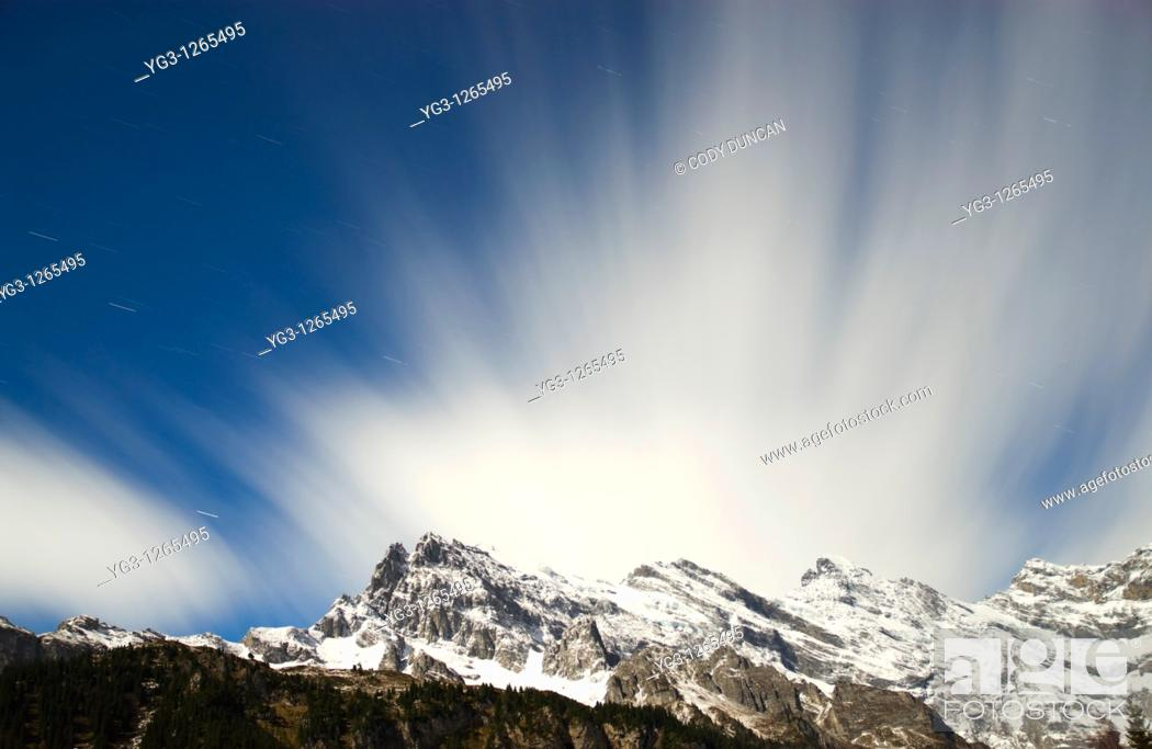 Stock Photo: Clouds moving over Bernese alps in winter, Gimmelwald, Switzerland.