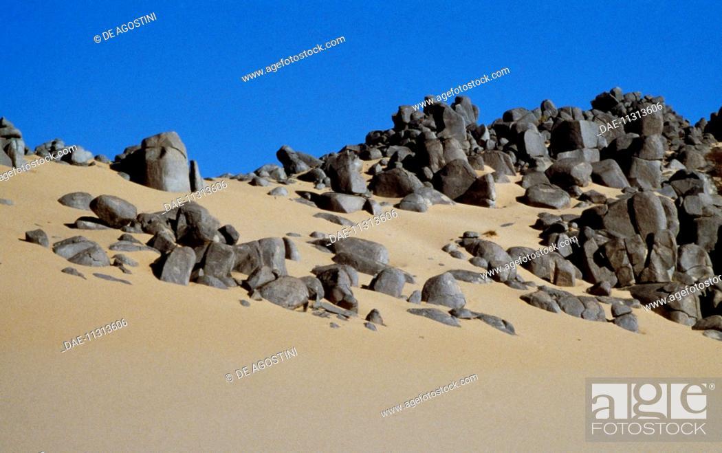 Stock Photo: Sand and rocks on the border between the Tassili n'Ajjer and Erg Amer, Sahara Desert, Algeria.