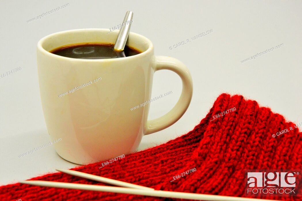 Stock Photo: Cup of coffee next to knitting.