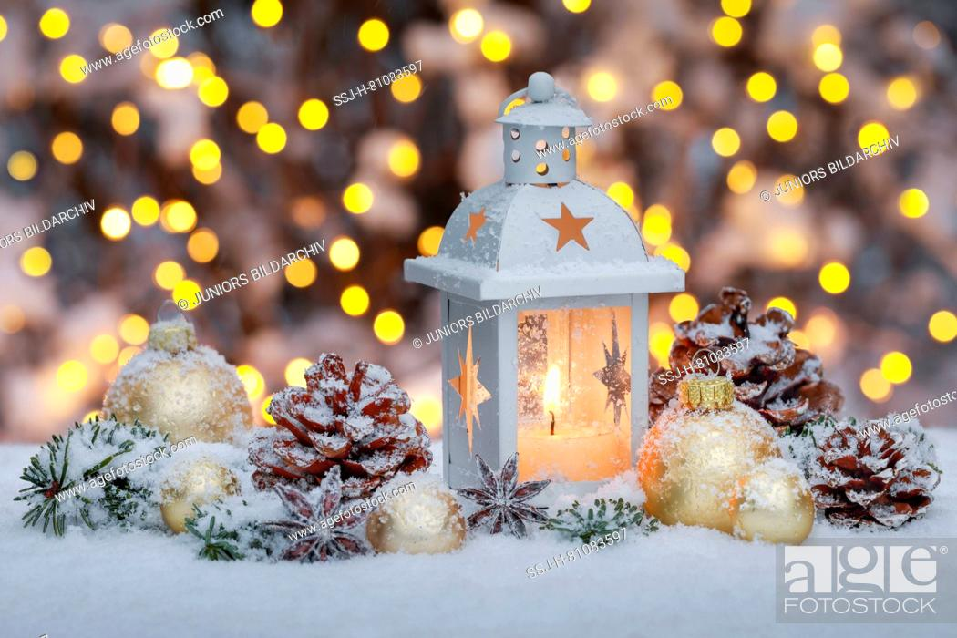 Stock Photo: Lantern with Christmas decoration in snow. Switzerland.