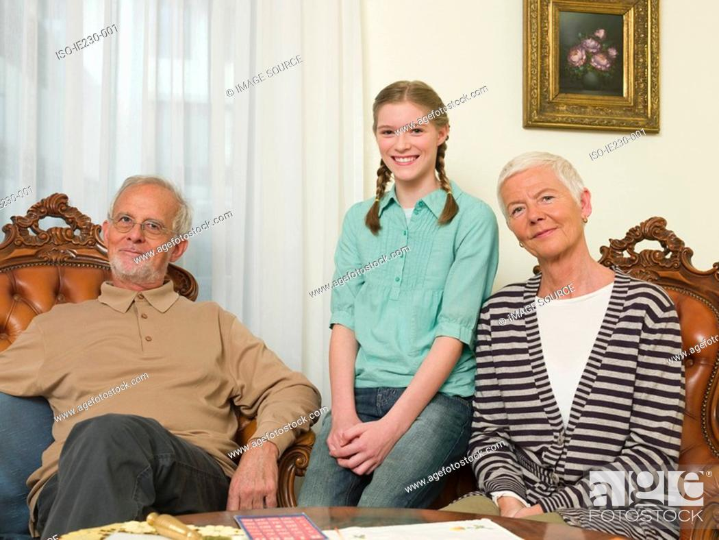 Stock Photo: Granddaughter with grandparents.
