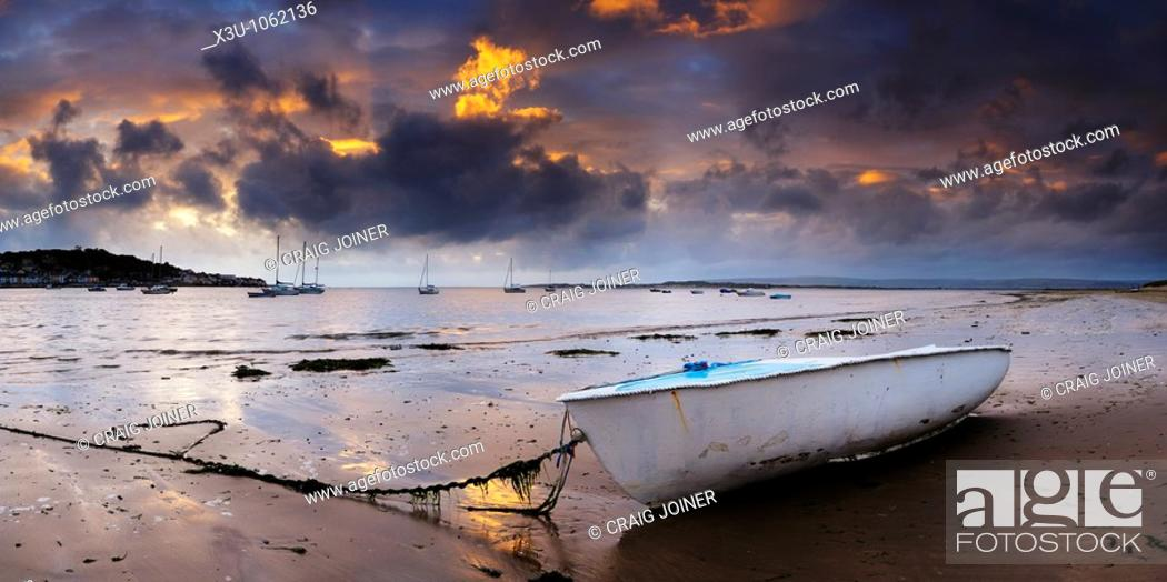 Stock Photo: Dusk light over Appledore and the Torridge and Taw estuary viewed from the beach at Instow in Devon, United Kingdom.