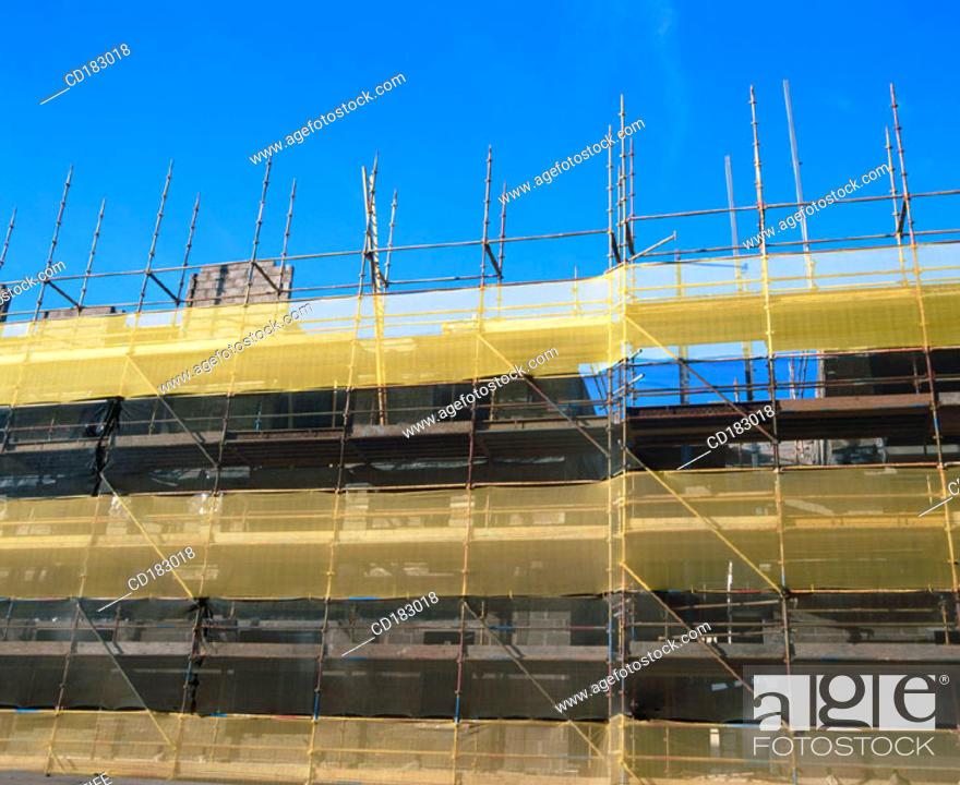Stock Photo: Scaffolding. Block of flats under construction.
