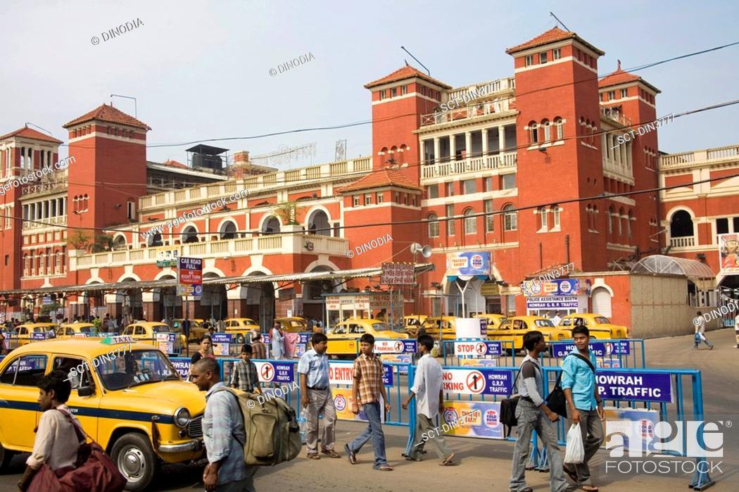 Stock Photo: Howrah Railway station architecture , Street Scene , Calcutta Kolkata , West Bengal , India.