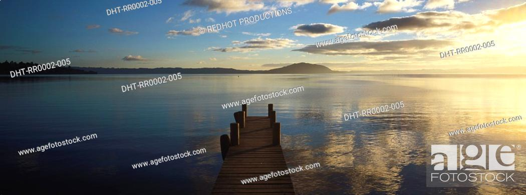 Stock Photo: Landscape view with body of water and dock.