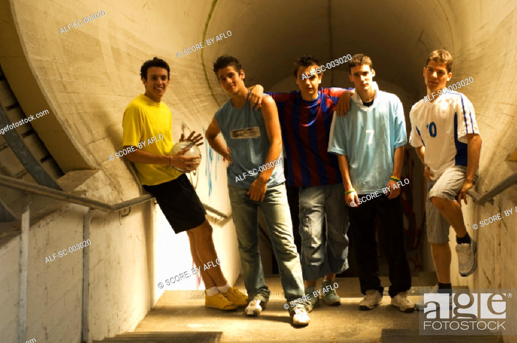 Stock Photo: Group of teenage soccer friends in tunnel.