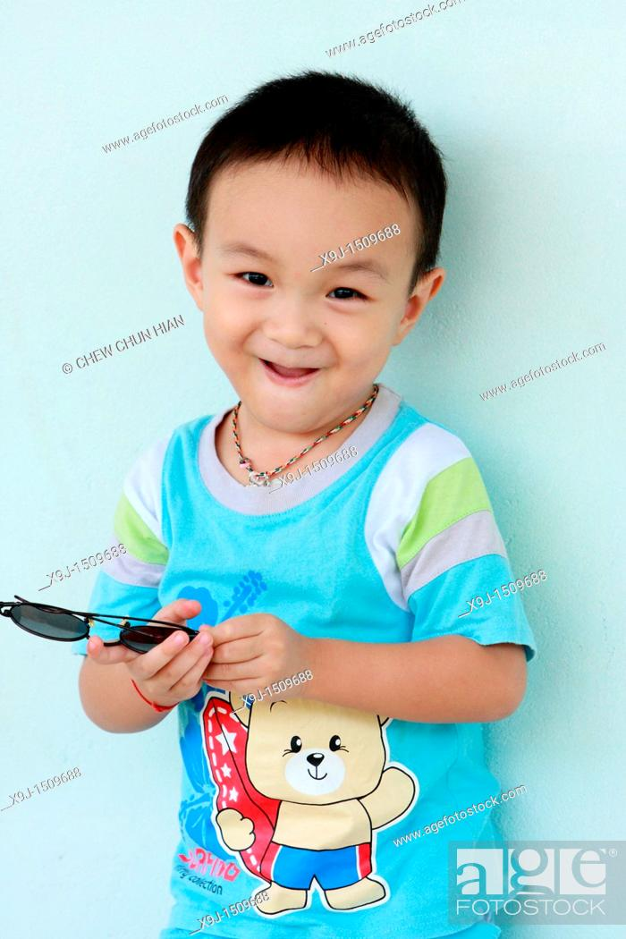 Stock Photo: Portrait of a boy with funny face.