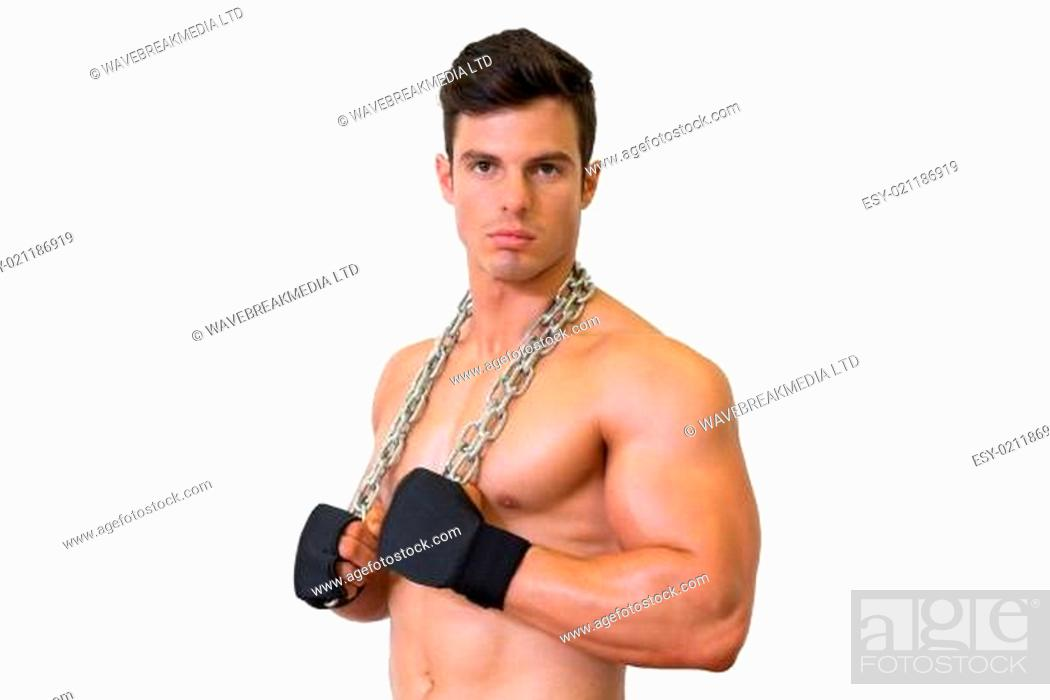 Stock Photo: Portrait of a serious shirtless muscular man.