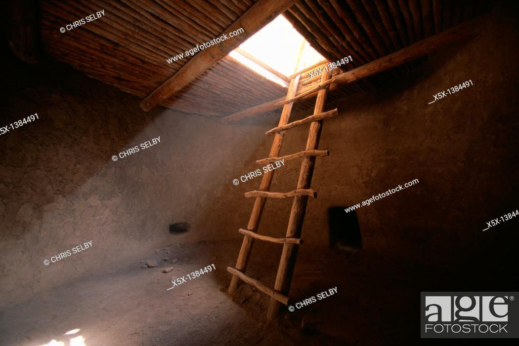 Stock Photo: Ladder descends into anasazi kiva, Bandelier National Monument, New Mexico, USA.
